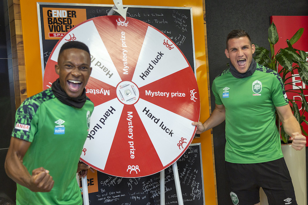 Image caption: Amazulu FC's Sbusiso Mabiliso and Neil Boshoff joined the club's headline sponsor, SPAR, on Friday 20 November at the SPAR Head Office in Pinetown, Durban, in support of the inaugural Mr Price Foundation Challenge in partnership with Comrades Marathon. The virtual Challenge which takes place on December 5 and 6, invites fun and fitness fanatics around the world to ride or run to raise funds for the Mr Price Foundation's education and skills development programmes.