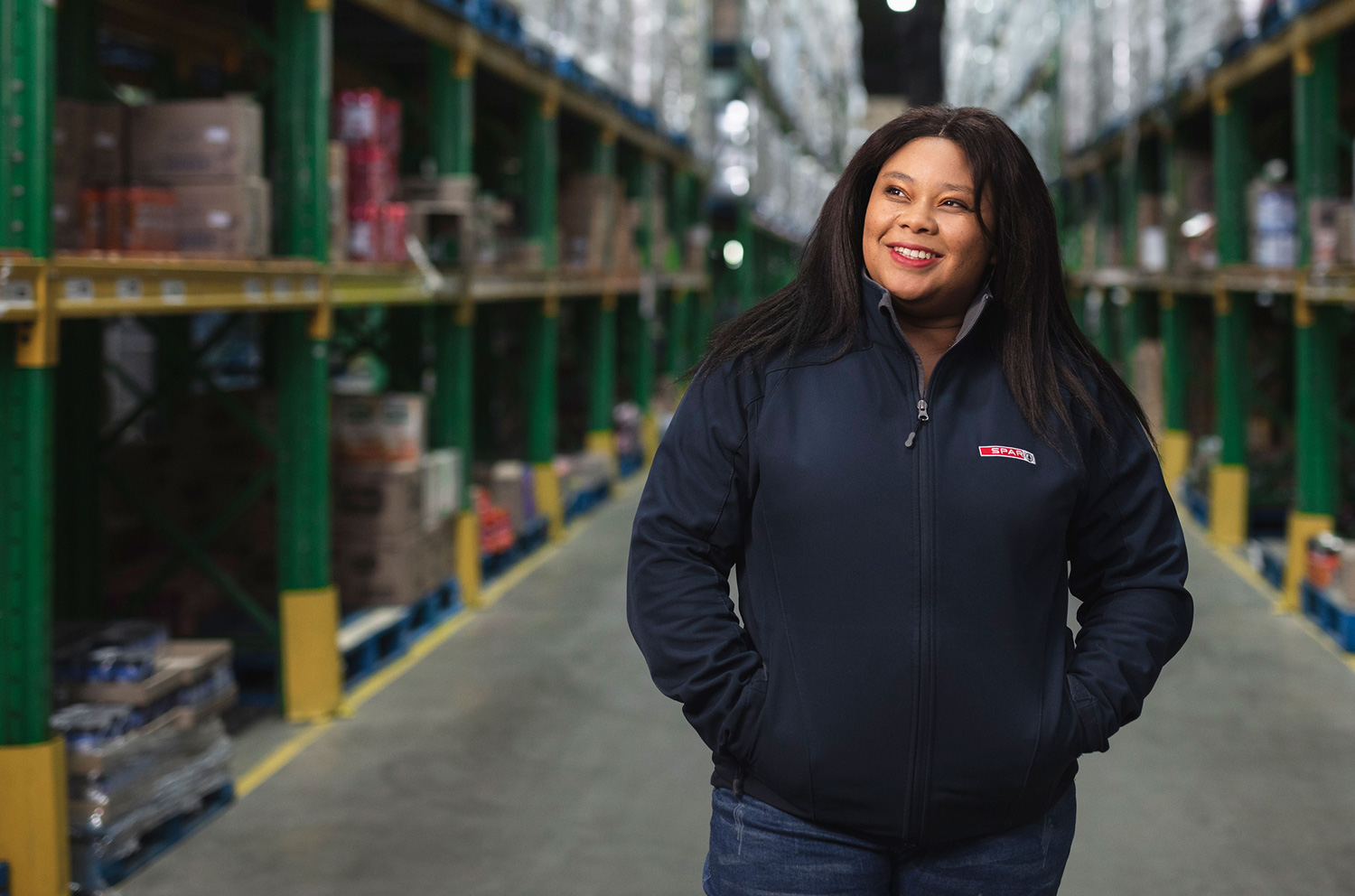 STRONG WOMAN: Siphokazi Mangesi, a Store Clerk in the Inventory Department at the SPAR Distribution Centre in Port Elizabeth, South Africa, is a shining example of the partnership outcomes between the SPAR Group and the Mr Price Foundation's work readiness programme, Jump Start. Image: MRP Foundation / Ross Charnock